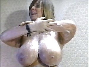 Busty babe in a hot vintage erotic show in the shower