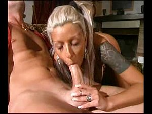 Blonde whore worships his massive cock before facial